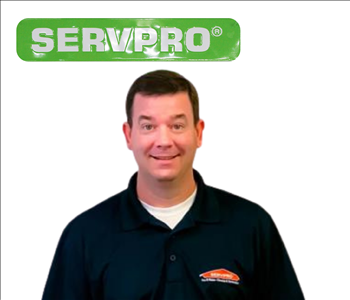 Brian Bell for SERVPRO photo on white wall