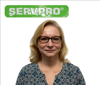 Janice Weyant for SERVPRO photo on white wall