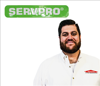 Ryan Millard for SERVPRO photo on white wall
