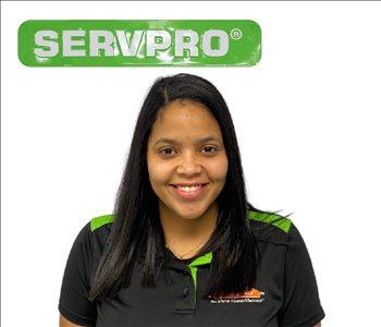 Female employee Patricia Delgado - Crew Chief with SERVPRO uniform in front of white wall