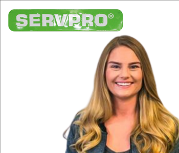 Cassie Yetton from SERVPRO photo on white wall, female employee with blonde hair
