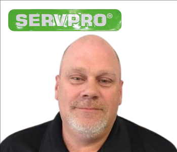 Kevin Woodard for SERVPRO photo on white wall