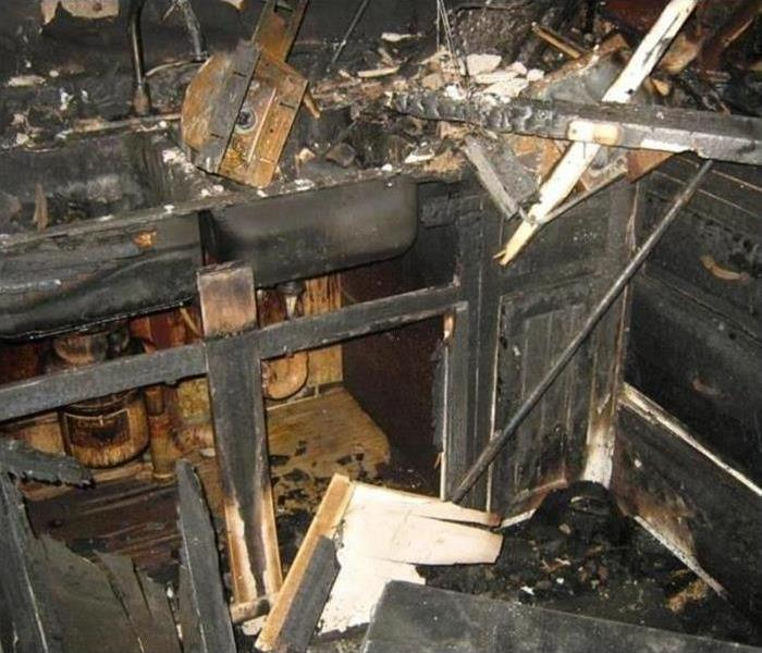 Fire damage destroys kitchen and soot is everywhere